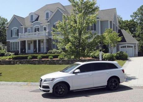 A judge seized former New England Patriot Aaron Hernandez's North Attleborough mansion while a wrongful death lawsuit is pending against him.